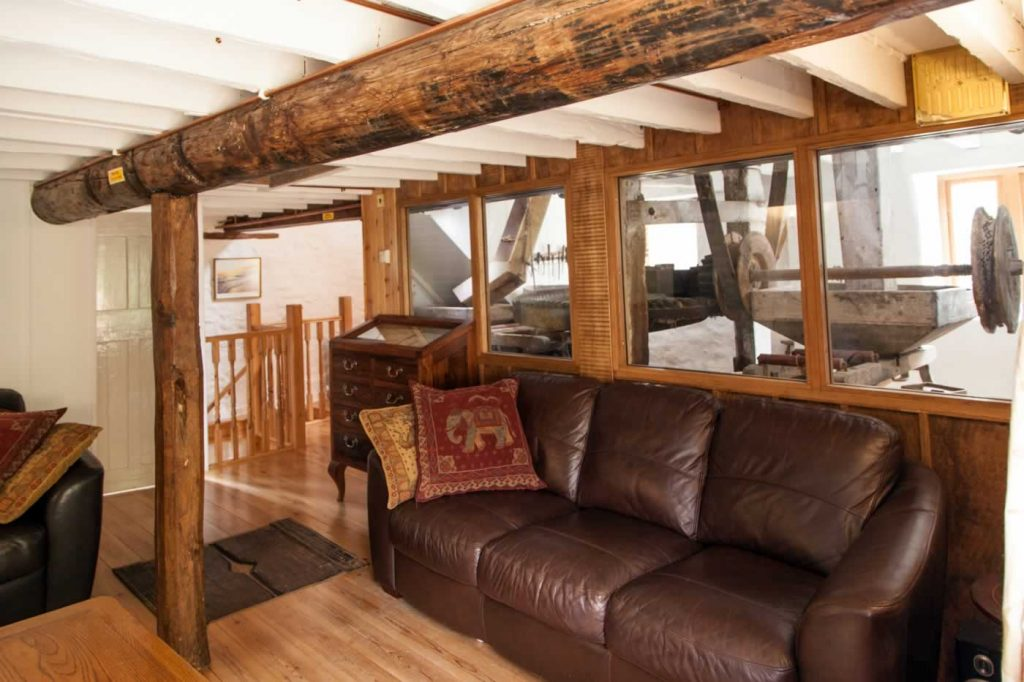 The Mill Living Area with waterwheel view