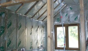 Insulation applied to walls and ceilings