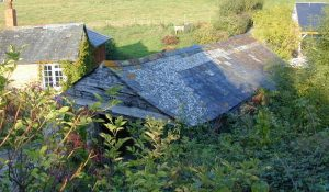 Barn roof showing ground level excavation needed for garden