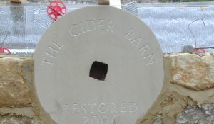 Orignal grinding stone now engraved and attached to the outside wall